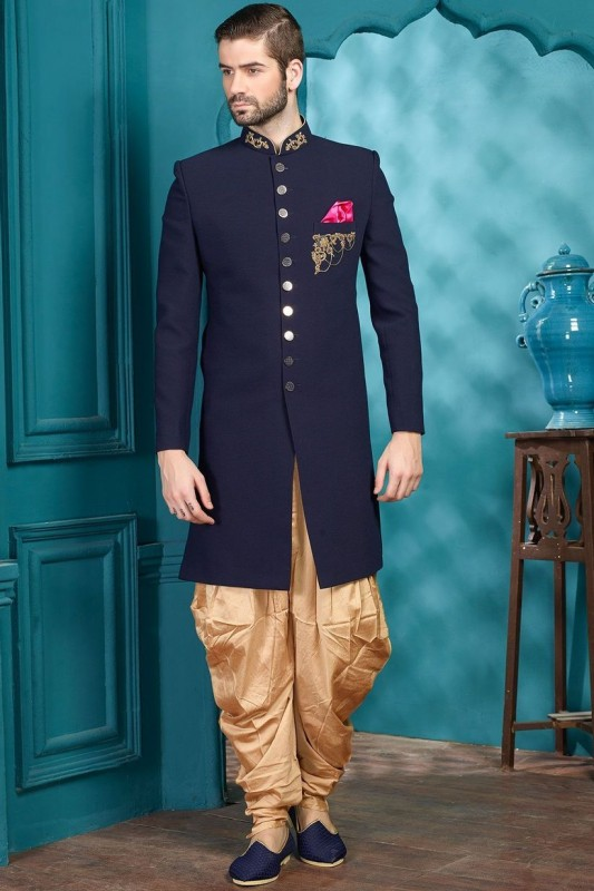 Wedding bells are ringing and love is in the air. Every man wants to look his absolute best on special days. While the wedding outfit is sorted as most of the men go for traditional outfits, choosing an engagement dress can be a daunting task. Choosing among the several ideas of engagement dresses for bridegroom is such a task!  Are you dodging between the perfect traditional outfit and a western outfit? Are you exploring new options and wish to try something new? If yes then you are in the right place because we have the most fashionable ideas for you. Here are a few outfits that every bridegroom must consider to wear on the engagement day:  Different Engagement Dresses for Bridegroom 1. Sherwani  One can never go wrong with a Sherwani. For all the grooms who want to opt for the traditional ways, pick out a gorgeous Sherwani. Pair it with jootis and you can even add a turban if you want the royal look. Wear some chains or a stole to complete the overall look.  Sherwani is probably the most loved and popular outfits for engagement ceremonies. Choose vibrant colours that will go with the theme of the engagement. You can also colour coordinate with your bride to be.        2. Suit up  If you want a traditional outfit for your wedding day and something different for your engagement then opt for a suit. The combination of well-fitted pants, a shirt and a nice blazer can never go out of style. For bridegrooms who would like to keep it classic, a black suit will do the job for you. Dress up formally to put the ring on your lady and bring out your inner gentleman.  Pair the outfit with formal shoes to give the ultimate touch to your special day. While opting for a three-piece suit, ensure that the fitting is up to the mark because it can either make or break your entire look.        Achkan  If you are stuck between a sherwani and a kurta-pyjama then Achkan is the way to go. It is basically a kurta which is inspired by the Mughals and their era. Achkan gives you the royal l