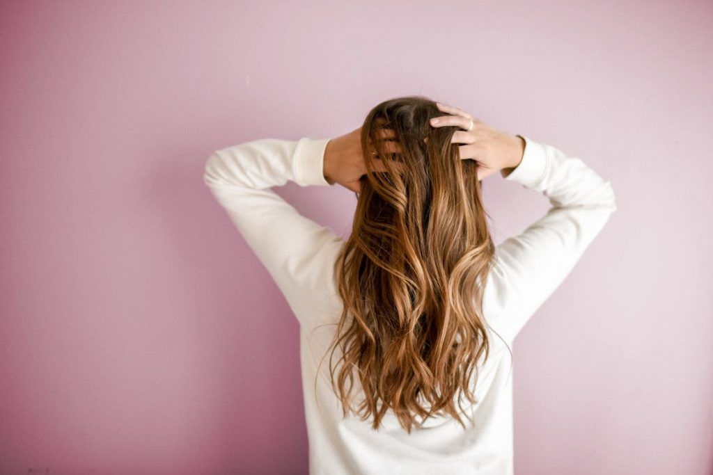 finger combing hair growth